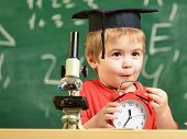 Pupil Waiting For School Break. Child On Excited Face Looks At Alarm Clock. School Break Concept. Ki poster