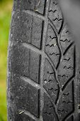 Damaged Black Tire Of A Large Car. Old Tires, Detail Of Old And Worn Wheels, Wheels To Pull. Deflate poster