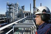 picture of refinery  - refinery worker with large petrochemical industry in background - JPG