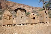 stock photo of dogon  - Granaries in a Dogon village Mali (Africa). The Dogon are best known for their mythology their mask dances wooden sculpture and their architecture. - JPG