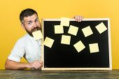 Notes. Business, Planning, Management, Reminder. People Concept. Smiling Bearded Man Holds Board Wit poster