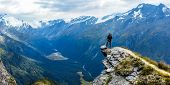 Traveler Standing At The Edge Of A Cliff With A Valley In The Distance. Cascade Saddle, Mount Aspiri poster