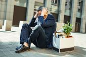 Clutching Head. Elderly Grey-haired Businessman Clutching His Head Outside The Street While Feeling  poster