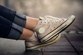 Women Legs. Sneakers On Girl Legs. Sneakers. Sneakers On Legs. Casual Clothing. Girl Wearing Sneaker poster