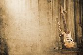 picture of sax  - old grungy sax with electric guitar in retro look - JPG