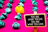 Conceptual Hand Writing Showing You Are What You Eat. You Are What You Love.. Business Photo Text St poster