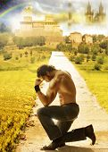 picture of humble  - Conceptual portrait of a shirtless man kneeling with a dreamy fantastical background far behind - JPG