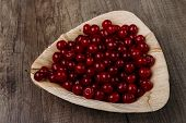 Fresh Red Cherries In A Wooden Plate On A Wooden Table. Wooden Plate On A Wooden Background. A Plate poster