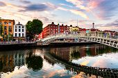 Dublin, Ireland. Night View Of Famous Illuminated Ha Penny Bridge In Dublin, Ireland At Sunset poster