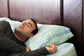 foto of late 20s  - A man in his late 20s is fast asleep in bed - JPG