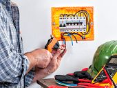 Electrician Technician At Work With Wire Stripper On Cables In A Residential Electrical Installation poster