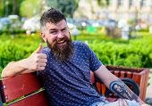 Rest And Relax Concept. Bearded Man With Fresh Haircut Relaxing, Urban Background. Hipster Enjoy Sun poster