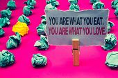 Writing Note Showing  You Are What You Eat. You Are What You Love.. Business Photo Showcasing Start  poster