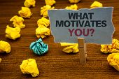 Writing Note Showing  What Motivates You Question. Business Photo Showcasing Passion Drive Incentive poster