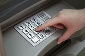 Close-up Of Handenting Pin Passcode On Atm Bank Machine Keypad. Female Hand Finger Presses The Atm B poster