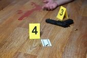 Bloody Crime Scene With Dead Body And Gun On Floor. Many Crime Scene Investigation Markers Indoors poster