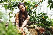 Pretty Islam Woman In Orange Grove Smiling, Real Muslim Girl Cheerful , Nature Organic People Concep poster