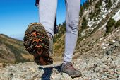 The Sole Of The Boot Is Close-up. Slender Women S Legs Amid The Slope. poster
