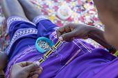 Making Of Handmade Jewellery. Masai African Women Hands, Top View, Close Up. Island Of Zanzibar, Tan poster