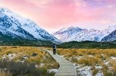 Hiking In Mountains At Winter. Mountain Landscape With Hiking Trek And Human At Sunset poster