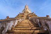 Stone Staircase To The Top Of Historic Buddhist Stupa Prang. Wat Arun Buddhist Complex Landmark. Ban poster