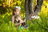 picture of fanny  - Little fanny girl playing with a cat in the park - JPG