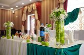 Beautiful Green And White Wedding Decor Of The Bride And Groom In A Restaurant. Apple Style In A Res poster