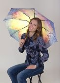 Pretty Young Woman Holding An Umbrella
