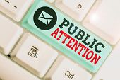 Handwriting Text Public Attention. Concept Meaning The Attention Or Focus Of The General Public To A poster