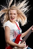 picture of stratocaster  - Woman playing the electrical guitar and have fun - JPG