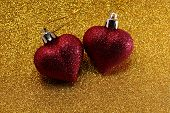 Two Red Hearts On Glittering Golden Glitter Background poster