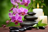 pic of stone-therapy  - zen basalt stones and bamboo on the wood - JPG