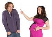 foto of gullible  - Pregnant woman pointing finger at man with hands in pockets - JPG