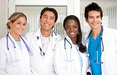 stock photo of medical staff  - Medical staff standing at the hospital smiling - JPG