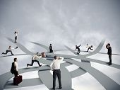 image of crossroads  - Concept of confusion and business career with business people - JPG