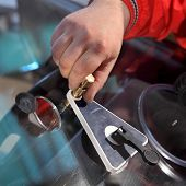 foto of vacuum pump  - Mechanic using repairing equipment to fix damaged windshield