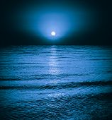 stock photo of moonlight  - Moon reflecting in a lake sea ocean waves - JPG