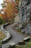stock photo of breath taking  - A curving path that leads hikers up to the summit of the mountain - JPG