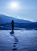 picture of girl walking away  - Image of lonely woman silhouette at winter mountains - JPG