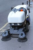 picture of sweeper  - Front view of street sweeper cleaning vehicle - JPG
