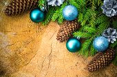 stock photo of blue spruce  - Christmas spruce branches pine cones and Christmas balls on a wooden background - JPG