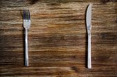 stock photo of knife  - Knife and fork set on a wooden vintage table - JPG