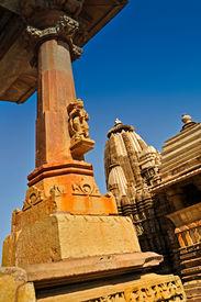 stock photo of kandariya mahadeva temple  - Sculptures of Kandariya Mahadeva Temple , dedicated to Lord Shiva , Western Temples of Khajuraho Madhya Pradesh , India - UNESCO world heritage site. Popular world tourist destination. ** Note: Slight graininess, best at smaller sizes - JPG