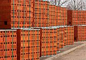 foto of skid  - Delivery of red bricks a popular building material ready for the construction of a new home by Builders - JPG