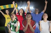 foto of football pitch  - Composite image of various football fans against football pitch under spotlights - JPG