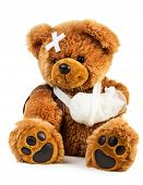 stock photo of trauma  - Teddy bear with bandage isolated on white background - JPG