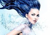 image of hair blowing  - Fashion model girl with water splash collar and long blowing blue hair - JPG