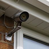 stock photo of cctv  - CCTV security camera mounted on house wall - JPG