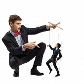 stock photo of obey  - puppeteer holds the puppet business man on the ropes - JPG