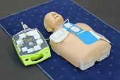 stock photo of defibrillator  - Automated External Defibrillator with training dummy mannequin - JPG